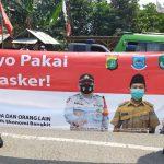 Polsek Cisauk, Koramil 03 Serpong bersama Tiga Pilar kecamatan Setu, menggelar kegiatan pembagian Masker Secara Serentak
