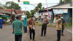 Cegah Penyebaran Covid -19, Bhabinkamtibmas Desa Dewasari Bersama Pemdes Giat Operasi Yustisi