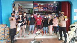 Antisipasi Penyebaran Covid-19, Polisi Bagikan Masker Di Pasar Ditengah PPKM