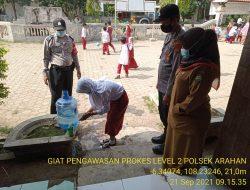 Pengawasan Pendisiplinan Prokes Anggota Polsek Arahan Di SDN 2 Pranggong