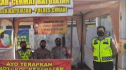 Anggota Polsek Batujajar Awasi Kegiatan Masyarakat di Pasar Tradisional